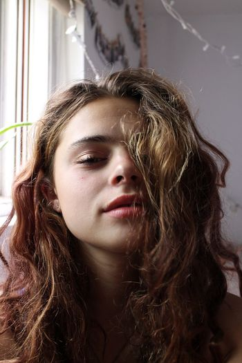 Portrait of teenage girl at home