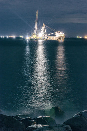 Into the light Nautical Vessel Nature Beach Night Reflection Longexposures Photographs Photography