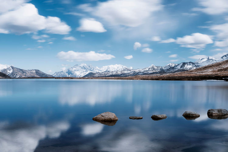 Blue sky, white clouds, snowy mountains, lake China Landscape Mountain Sky Cloud - Sky Beauty In Nature Nature Scenics - Nature Travel Destinations Travel Lake Reflection Day Snowcapped Mountain Rock Stone Water Environment Cold Temperature Waterfront Scenery No People Snow Mountain Peak