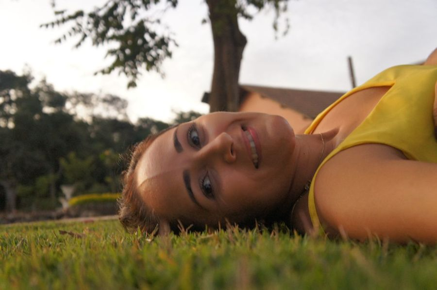 Floor EyeEm Selects Tree Portrait Smiling Lying Down Beauty Headshot Summer Looking At Camera Grass Close-up Growing Pretty Calm Sunset Tranquility Sun Tranquil Scene