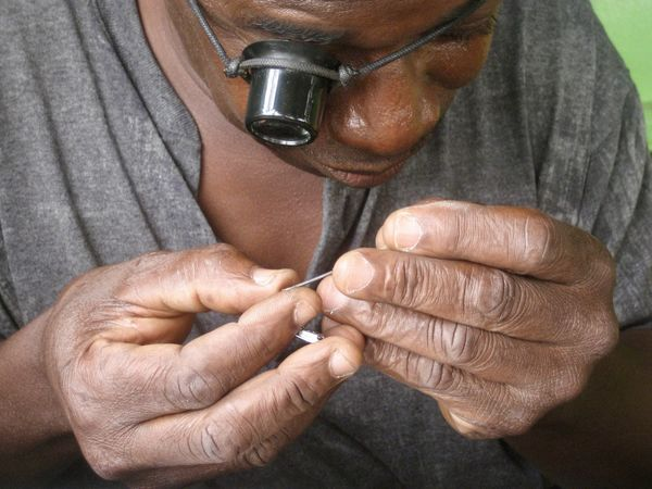 Concentration Africa Man Craft Repair Clockwork Adult Tweezers Magnifying Glass Concentrated Holding Front View Occupation Watchmaker Enlarge Craftman Craftmanship Handwork One Person Small Business Enlargement Human Hand Human Body Part Midsection Skills