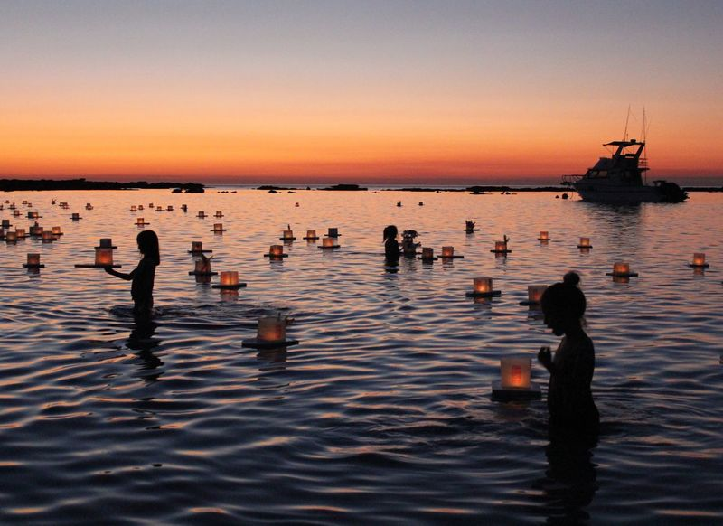 Floating hopes. Sunset Water Nature Silhouette Sky Reflection Beach Sea Beauty In Nature Outdoors Tranquility Scenics Women Lifestyles Clear Sky Real People Horizon Over Water Day Lanterns The Week On EyeEm