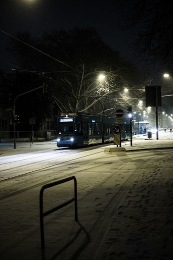 Illuminated street lights in winter at night