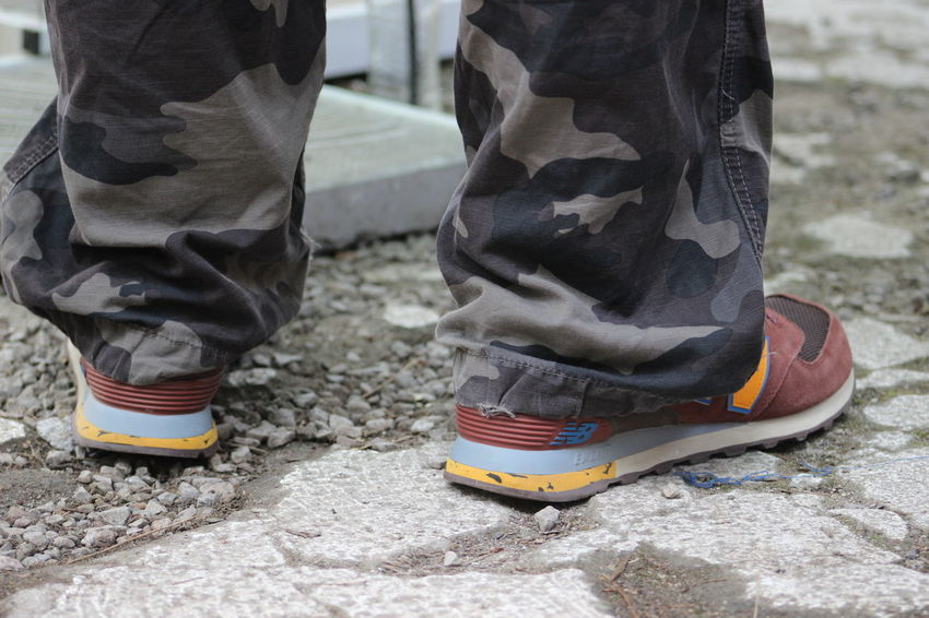 Casual Clothing Close-up Day Focus On Foreground Footwear Ground Leisure Activity Lifestyles Low Section Multi Colored Outdoors Pair Part Of Selective Focus Shoes Unrecognizable Person
