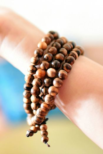 Cropped hand wearing beads bracelet