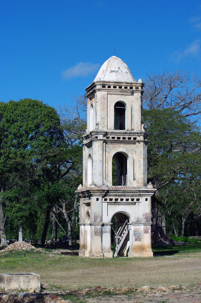 Cuba Rock Slavery Trinidad Arch Architecture Belief Blue Building Exterior Built Structure Colonization Day Discovery History Nature No People Outdoors Place Of Worship Plant Plantation Religion Sky Slave Spirituality Sugar Cane The Past Tourism Tower Travel Destinations Tree Valle De Los Ingenios Watching