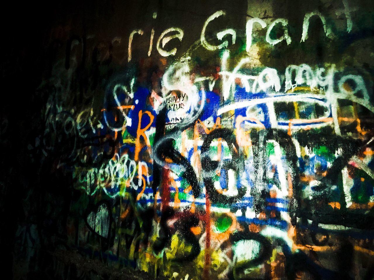 text, graffiti, illuminated, communication, no people, night, close-up, multi colored, architecture, outdoors