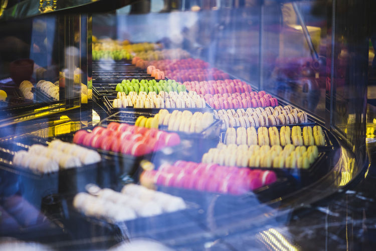 Macarons!! Holiday Moments Macarons Food Colorful Temptation Retail Display In A Row Store Glass - Material Transparent Selective Focus No People For Sale Choice Food And Drink Bakery French Food Tea Time Pastries Real Sweet Food