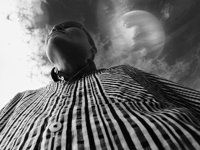 Directly below shot of man standing against sky