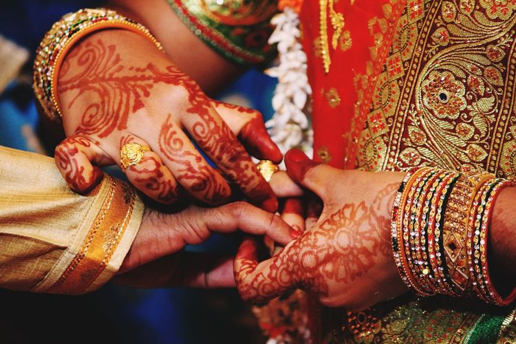 Midsection of bride exchanging ring during wedding ceremony