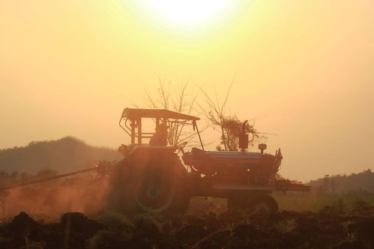 Agricultural Agriculture Clear Sky Cultivated Land Farm Farmer Farming Farmland Industry Land Machine Machinery Plough Preparation  Rural Season  Silhouette Sky Soil Sowing Spring Summer Sunset Tractor Vehicle