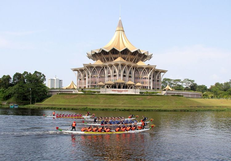 Dragon boat race Built Structure Water Sky Architecture Group Of People Building Exterior Summer Sports Real People