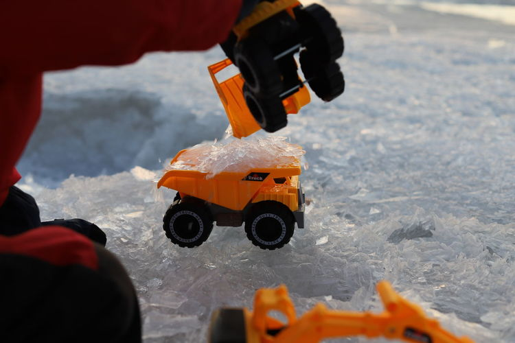Close-up of toy car on snow