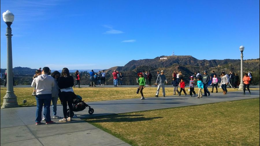 People Walking Grass Hollywood Sign Mountain