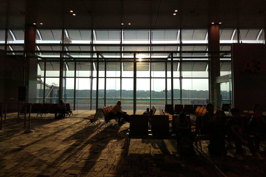 Departure hall Changi Airport Transit Adult Architecture Built Structure Ceiling Day Departure Glass - Material Group Group Of People Hall Indoors  Lifestyles Light And Shadow Medium Group Of People Men Nature People Real People Shadow Sunlight Sunset Window Women