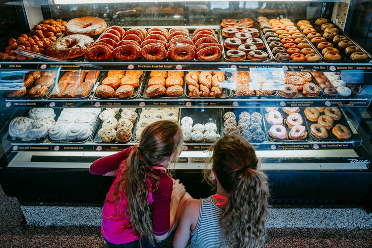 donuts Day Donut Food Food And Drink Freshness Indoors  Leisure Activity Lifestyles Meat People Ready-to-eat Real People Retail  Togetherness Two People