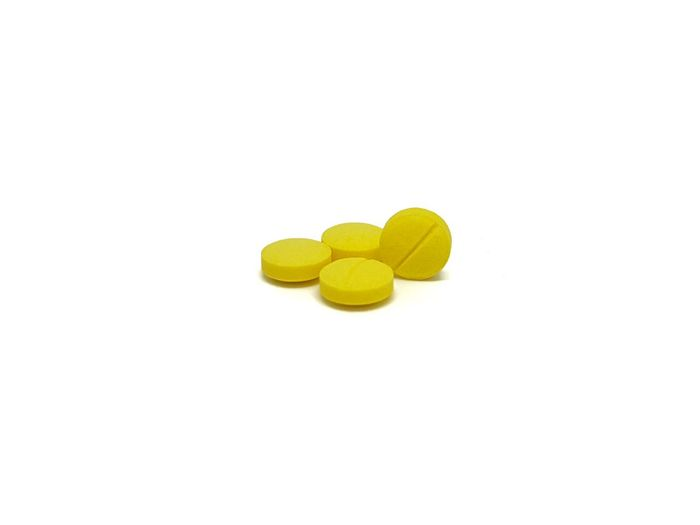 EyeEm Selects yellow medicine tablet on white background. Yellow White Background No People Capsule Tablets💊 Close-up Medicine Health Care Pill