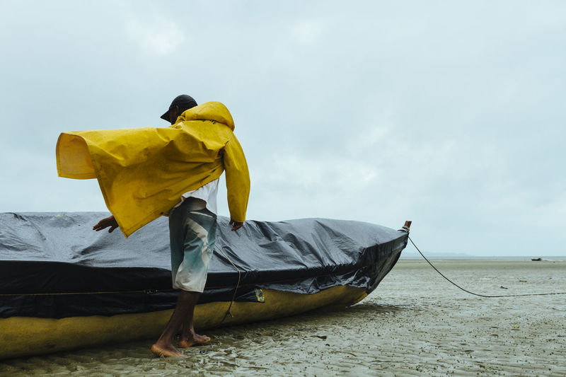 Paint The Town Yellow Rainy Days Cloud - Sky Day Fisherman Fisherman Boat Fishermen's Life Full Length Men One Person Outdoors Raincoat Rainy Day Real People Sky Yellow The Week On EyeEm