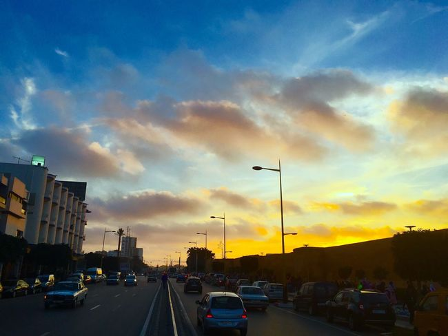 Car Transportation Sky Sunset City Cloud - Sky Road Land Vehicle Building Exterior Architecture Built Structure No People Outdoors Cityscape Day