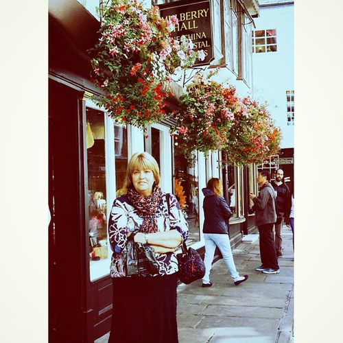 Lovely lady outside Mulberry Hall York Lady Mulberry hallSummer flowersbaskets