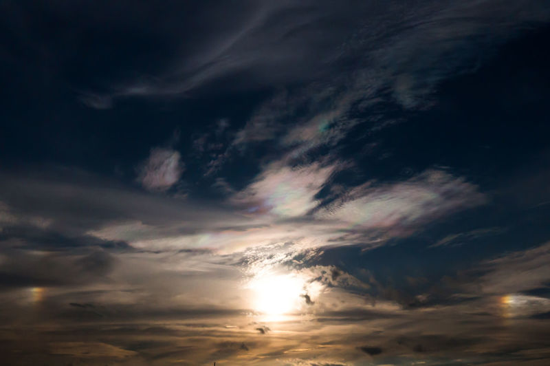 Sun dog is the name of atmospheric effect when two phantom suns appear Suns Appear When There Are Two Sunset Scenics Tranquil Scene Beauty In Nature Sun Cloud Majestic Sunbeam Outdoors Cloudscape Sun Dog Sun Dogs Sun Dogs In The Sky Parhelion Parhelia Halo Effect Cloud - Sky Sky Tranquility Rainbows