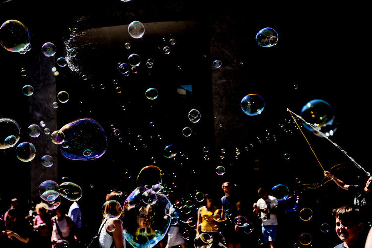 Adult Bubble Bubble Wand Enjoyment Fragility Fun Group Of People Leisure Activity Lightweight Mid-air Motion Multi Colored Nature People Real People Shape Soap Sud Sphere Transparent Vulnerability  Women