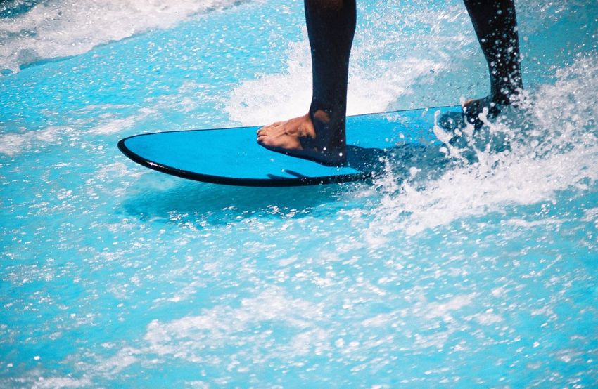 Sommergefühle Water Surf Low Section One Person Human Leg Human Body Part Sport Men Leisure Activity Outdoors Lifestyles Day Motion Real People One Man Only Swimming Adults Only Nature People Only Men Film 35mm Film
