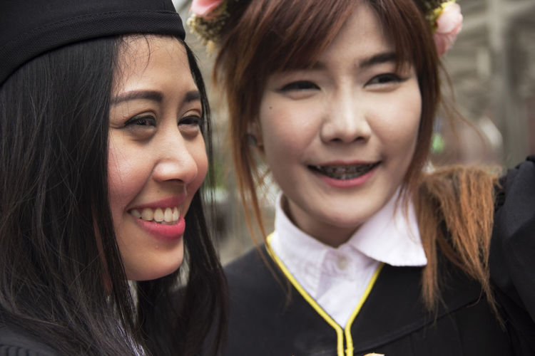 Close-up of smiling female friends outdoors