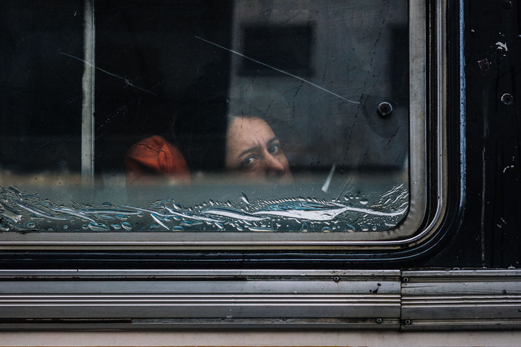 A last glimpse Window One Person Glass - Material Real People Adult Portrait Reflection Headshot Mode Of Transportation Mid Adult Transportation Young Adult Indoors  Transparent Looking Land Vehicle Motor Vehicle Mirror Front View Streetphotography Street Photography Streetphoto EyeEm Selects The Street Photographer - 2019 EyeEm Awards