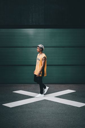 X-Man X Road Marking Full Length One Person Standing Outdoors Day Colour Your Horizn Sports Clothing Lifestyles Young Adult People City