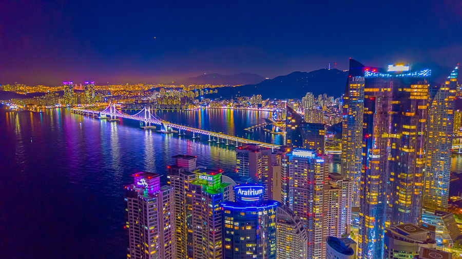 Aerial view of Busan city at night time, South Korea. Busan Haeundae Busan,Korea Gwangan Bridge Gwangandaegyo Gwanganli Haeundae Beach Korea Aerial View Architecture Building Exterior Built Structure Busan Busan Night City Cityscape Gwangali Beach Gwangalli Haeundae Illuminated Korea Aerial View Night Office Building Exterior Outdoors Sky Skyscraper