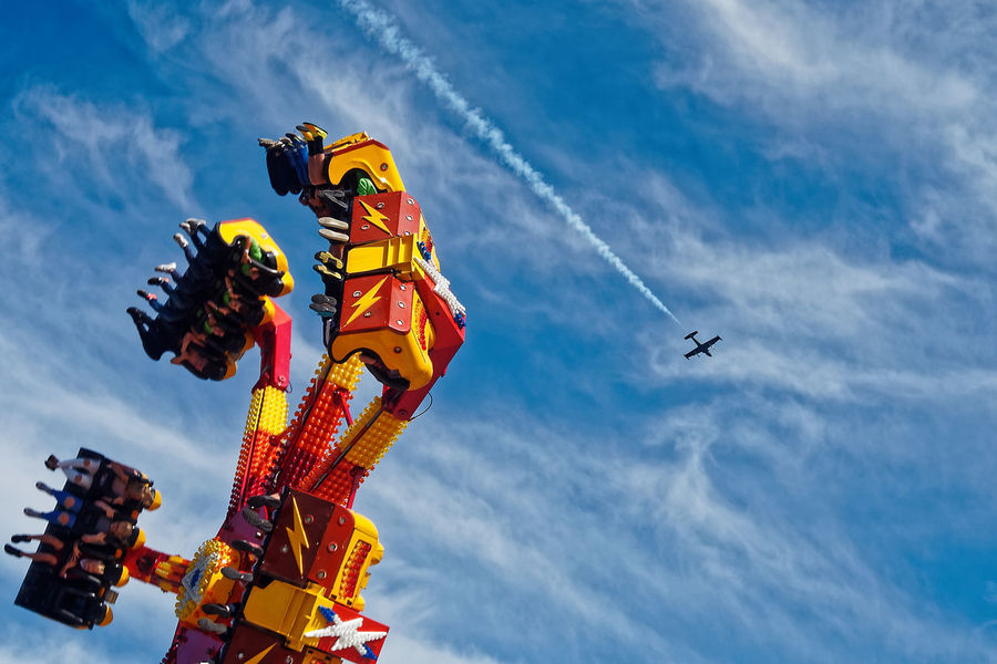 Air Vehicle Airplane Airshow Cloud - Sky Day Extreme Sports Firefighter Flying Low Angle View Men Mid-air Outdoors People Real People Sky Stunt Stunt Person Teamwork Vapor Trail