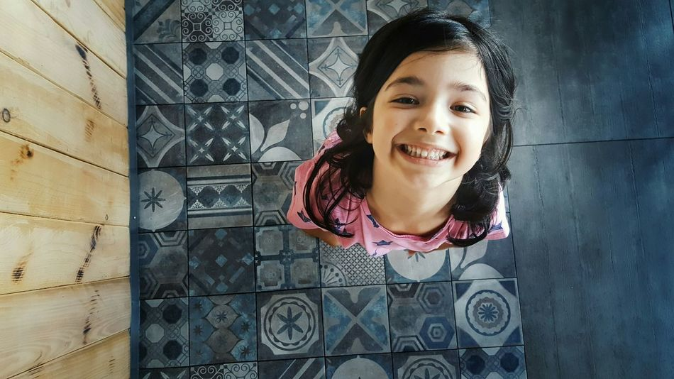 Look Up And Thrive Little Girl My Daughter Looking At Camera Smiling Enjoying Life Casual Clothing Pattern Design Tiled Floor Tiles Mosaic Floor Vintage Tiles Textures Tilesart The Human Condition Humaninterest Tiles Art Tiles Of Morocco Selective Focus Beautiful Girl Having Fun Eye4photography  Kidsphotography Childhood Children Photography My Love