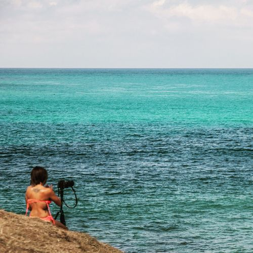 Girl & canon Sea Horizon Over Water Real People Water One Person Leisure Activity Beach Lifestyles Scenics Sky Outdoors Nature Full Length Day Sitting Vacations Beauty In Nature Shirtless Landscape INDONESIA Lombok Island