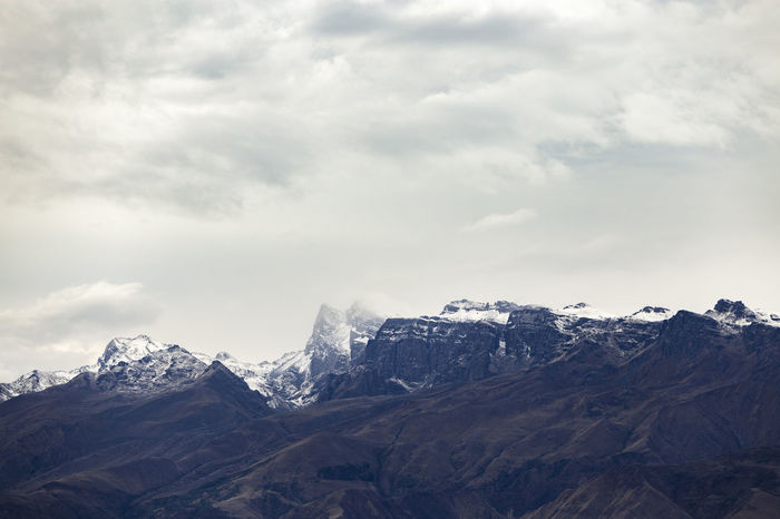 Snow capped mountains Bolivia Cochabamba Hiking Mountain View Sky And Clouds Winter Beauty In Nature Day Hike Landscape Mountain Mountain Range Mountains Mountains And Sky Nature No People Outdoors Range Scenery Sky Snow Snow Covered Snow Mountain Snowing South America