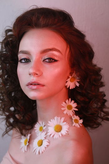 Side View Portrait Of Teenage Girl Wearing Flowers