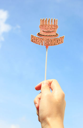 Human Hand Hand Human Body Part Sky One Person Holding Real People Personal Perspective Text Nature Day Finger Body Part Low Angle View Blue Human Finger Outdoors Temptation Happy Birthday! Party Party Time Birthday