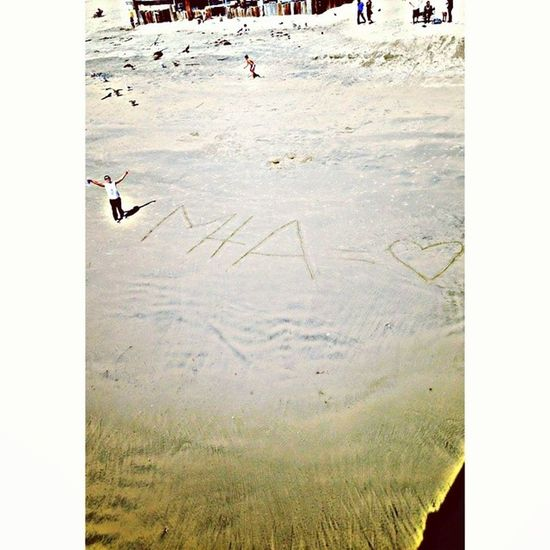 He ran off the pier and had me waiting, as I soon noticed he was writing our initials on the sand <33333 Lovehim Cutestthing Lettersbiggerthenhimtho Hahah