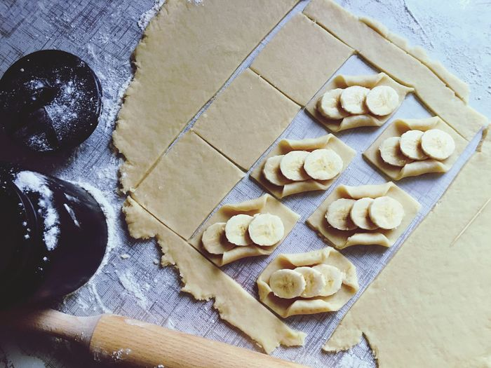 High angle view of banana on dough over kitchen counter
