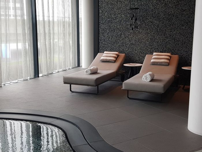 Relaxation area by jacuzzi pool Luxurylifestyle  Luxury Hotel Interior Design Modern Interior Jacuzzi  Spa Spa Area Lounging Long Chair Relaxation At The Hotel Hotel Indoors  Still Life