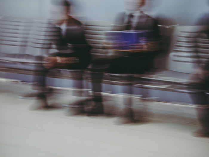 Blurred motion of people walking on street in city