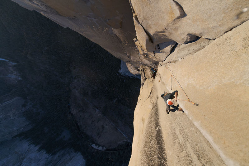 High angle view of people walking on rock