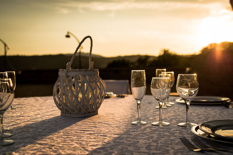 Close-Up Of Alcoholic Drinks Served On Table Against Sky During Sunset