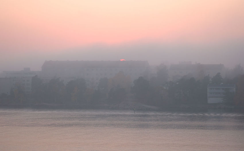 Sun peeking behind the building Buoy Waves Water Shot From Above  View From Above Peaceful View Peaceful Architecture No People Sun Apartment Buildings Sea Waterfront Building Exterior Sun Peeks Peeking Sun Sunset Orange Color Pink Color Hazy  Foggy Haze Fog Gh5