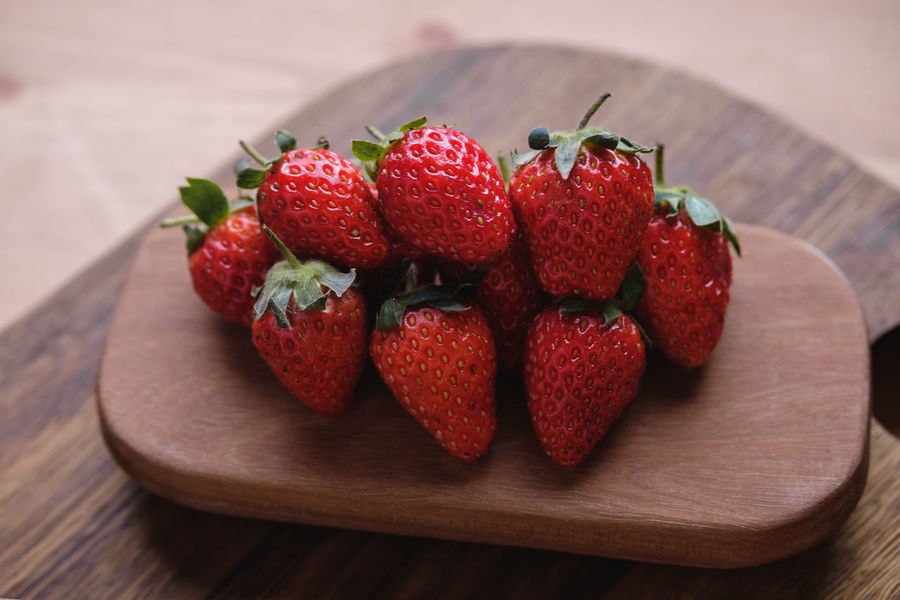 Strawberry Berry Fruit Close-up Cutting Board Focus On Foreground Food Food And Drink Freshness Fruit Healthy Eating Indoors  Juicy Large Group Of Objects No People Red Ripe Still Life Strawberry Table Wellbeing Wood - Material