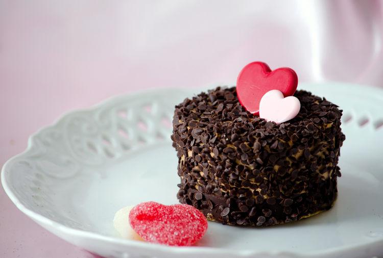 Close-up of heart shape cake on plate