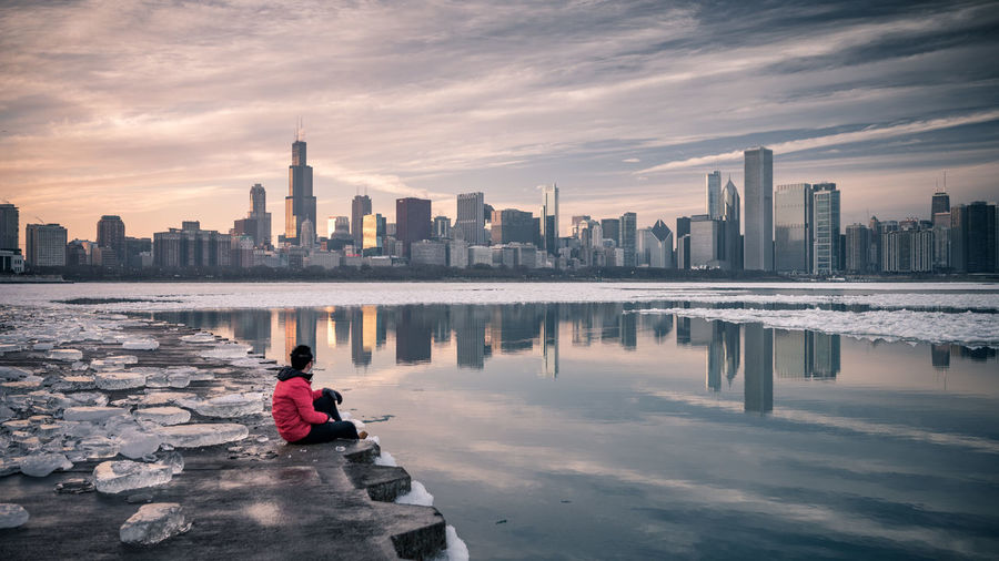 Enjoy the moment Alone Exploring Ice Taking Photos Tranquility Travel Winter Architecture Building Exterior Built Structure City Cityscape Cloud - Sky Cold Temperature Enjoying Life Landscape Leisure Activity Modern One Person Reflection Skyscraper Sunset Travel Destinations Urban Skyline Water
