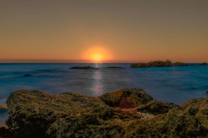 Sunset over the sea in Paphos, Cyprus Big Stopper  Blue Cyprus Dramatic Sky Dusk Horizon Horizon Over Water Light Long Exposure Mediterranean  Misty Nd ND Filter Ocean Orange Rays Rock Rocks Rocks And Water Sea Sunrise Sunset Sunshine Water