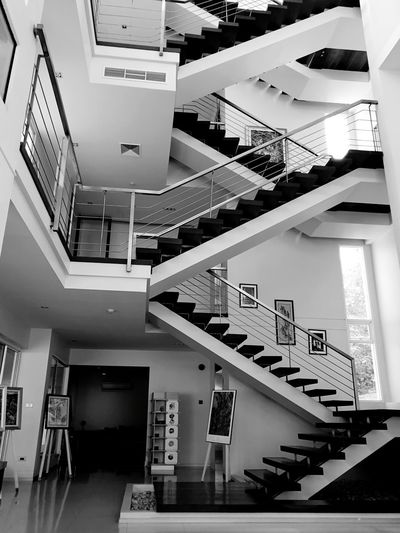 upstair House Interior Interior Design EyeEmNewHere Spiral Staircase Steps And Staircases Spiral Steps Staircase Stairs Railing Spiral Stairs High Angle View Architecture Hand Rail Moving Down Ceiling Light  Zigzag Stairway Escalator
