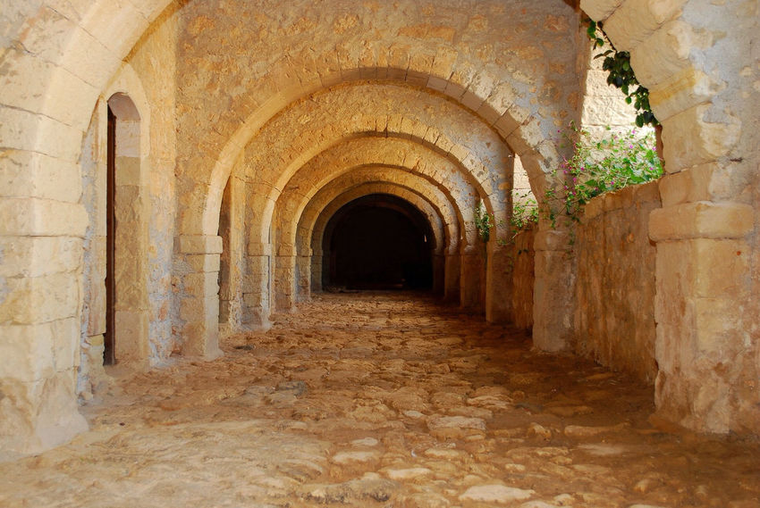Inside crete monastery Ancient Arcade Arch Arched Architectural Column Architecture Archway Built Structure Corridor Day Diminishing Perspective Historic History Interior Medieval Narrow No People Repetition Stone Material The Past The Way Forward Vanishing Point Window